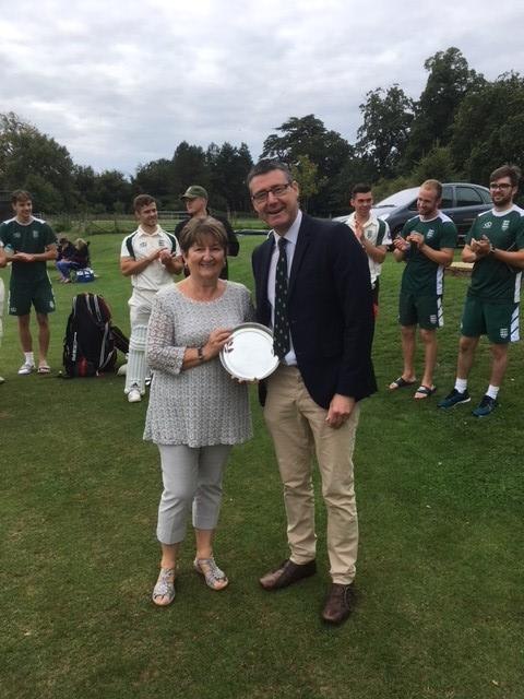 CENTURY DUTY: Chris Drew receives a silver salver from chairman Sean Walbridge to mark scoring 100 Minor Counties Championship matches for Dorset