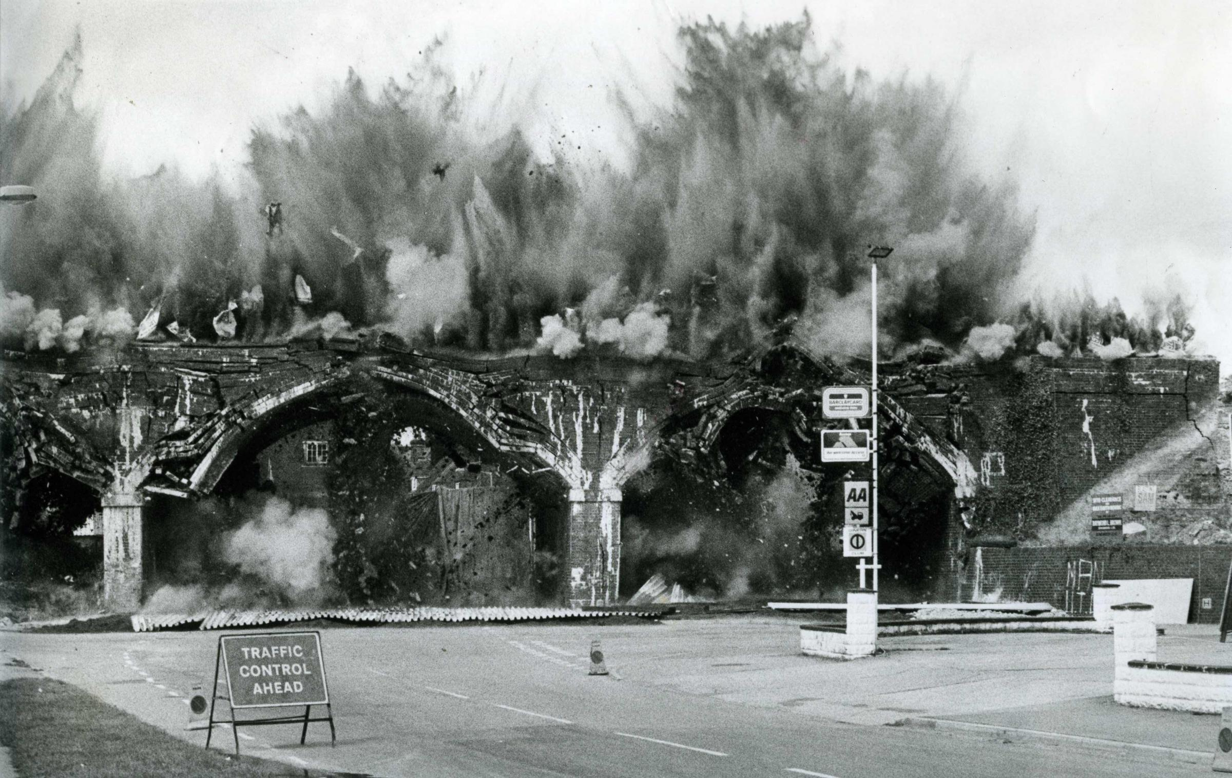 Dramatic explosion captured during the demolition of the Blandford Railway Arches in Blandford 1978.  Following the Bournemouth and Bath line closed to passenger back in 1966 the line remained open to goods traffic until 1969 when Blandford station was cl