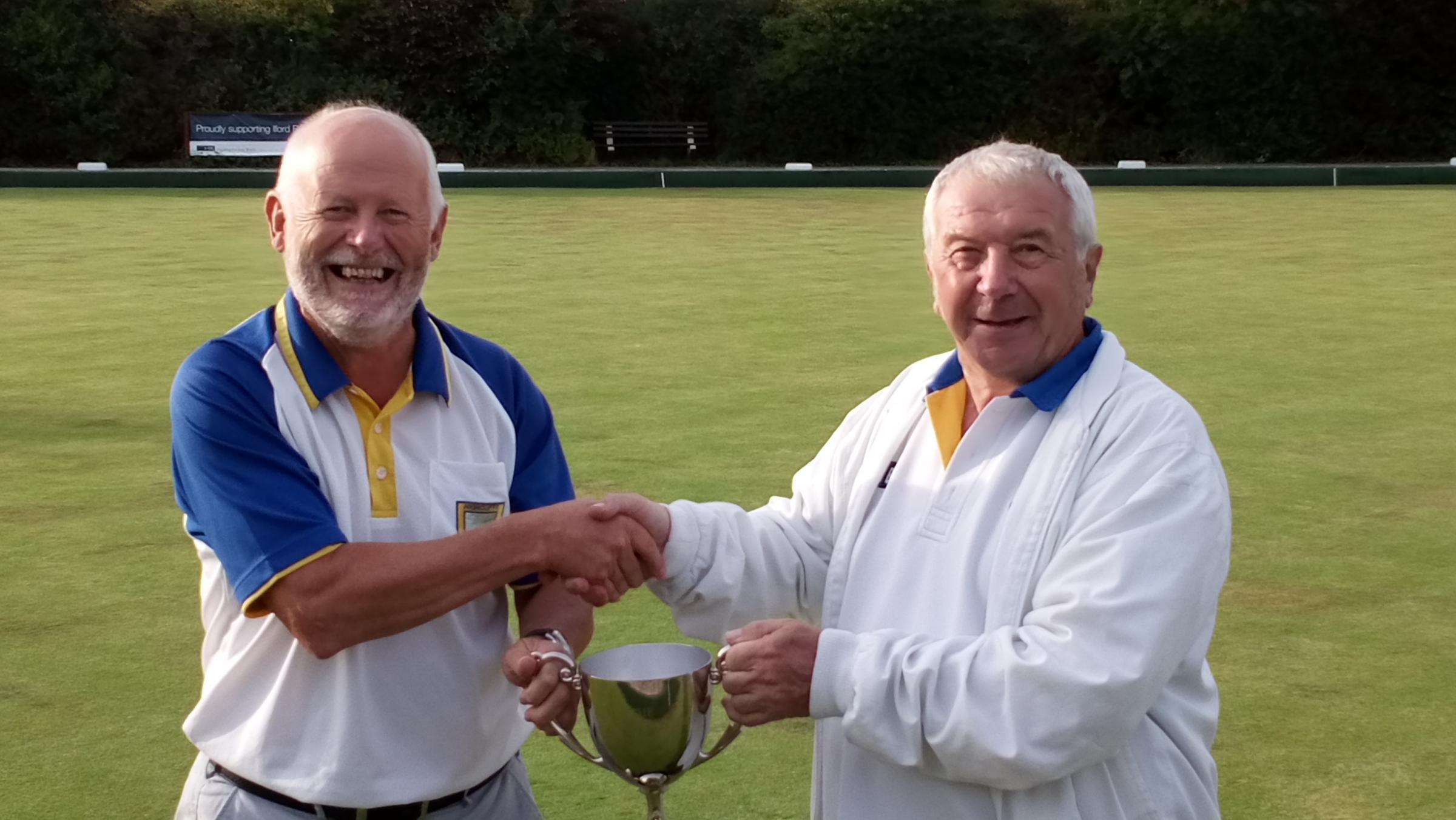 VICTORY: Mick McGing, Iford Bridge's president, presents the Christchurch Times Cup to Highcliffe captain Andy Phillips