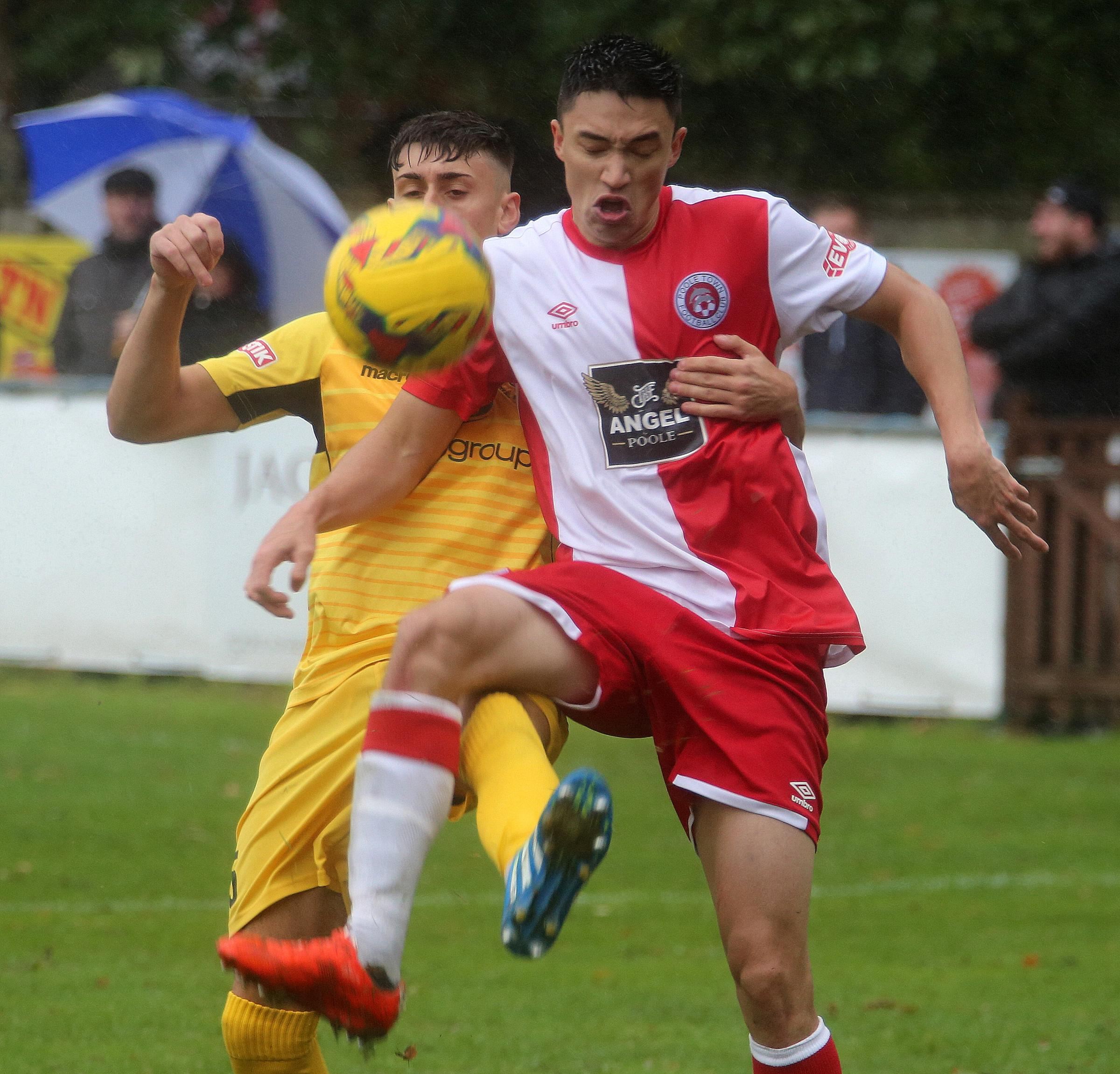 DUEL: Luke Roberts in action against Cinderford (Picture: Andy Orman)