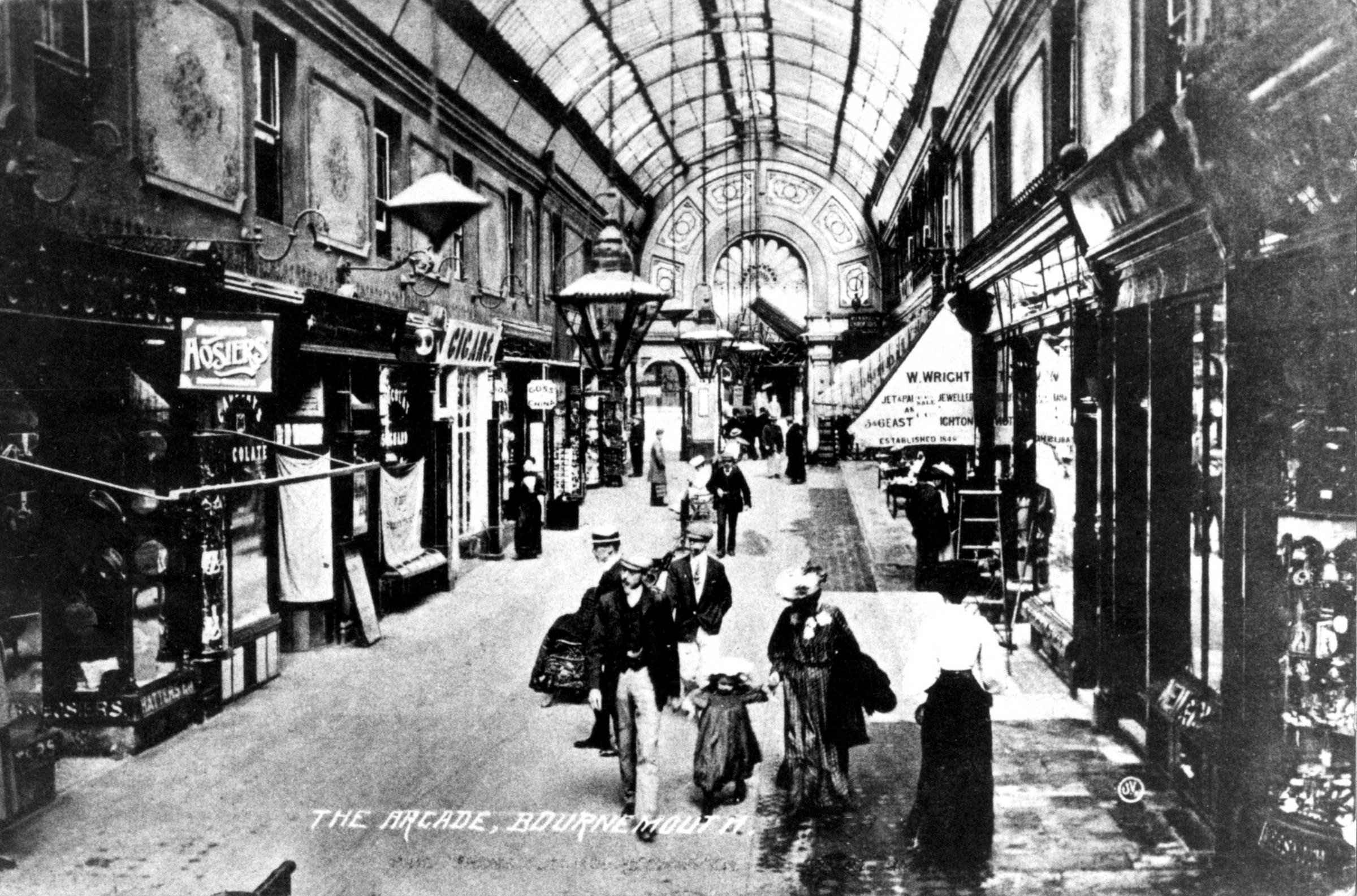 The Arcade Bournemouth pictured here in 1907,  also known as Henry Joy's Arcade and Gervis Arcade runs between Gervis Place and Old Christchurch Road.  The arcade building was originally constructed as two rows of shops, by Henry Joy in 1866. Six year
