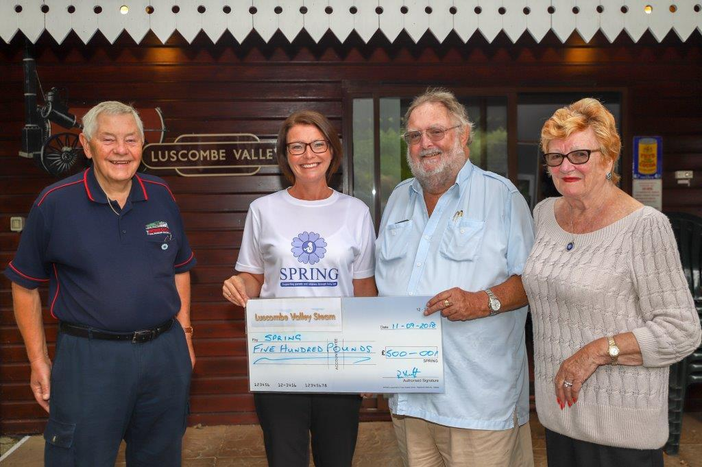 Richard and Connie Knott present a cheque to Janine Golding from Poole Hospital Charity, with volunteer Graham Scrivens. Picture: Scott Lovegrove