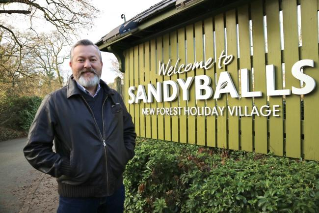 Carl Castledine, chief executive of Away Resorts, outside the entrance to Sandy Balls