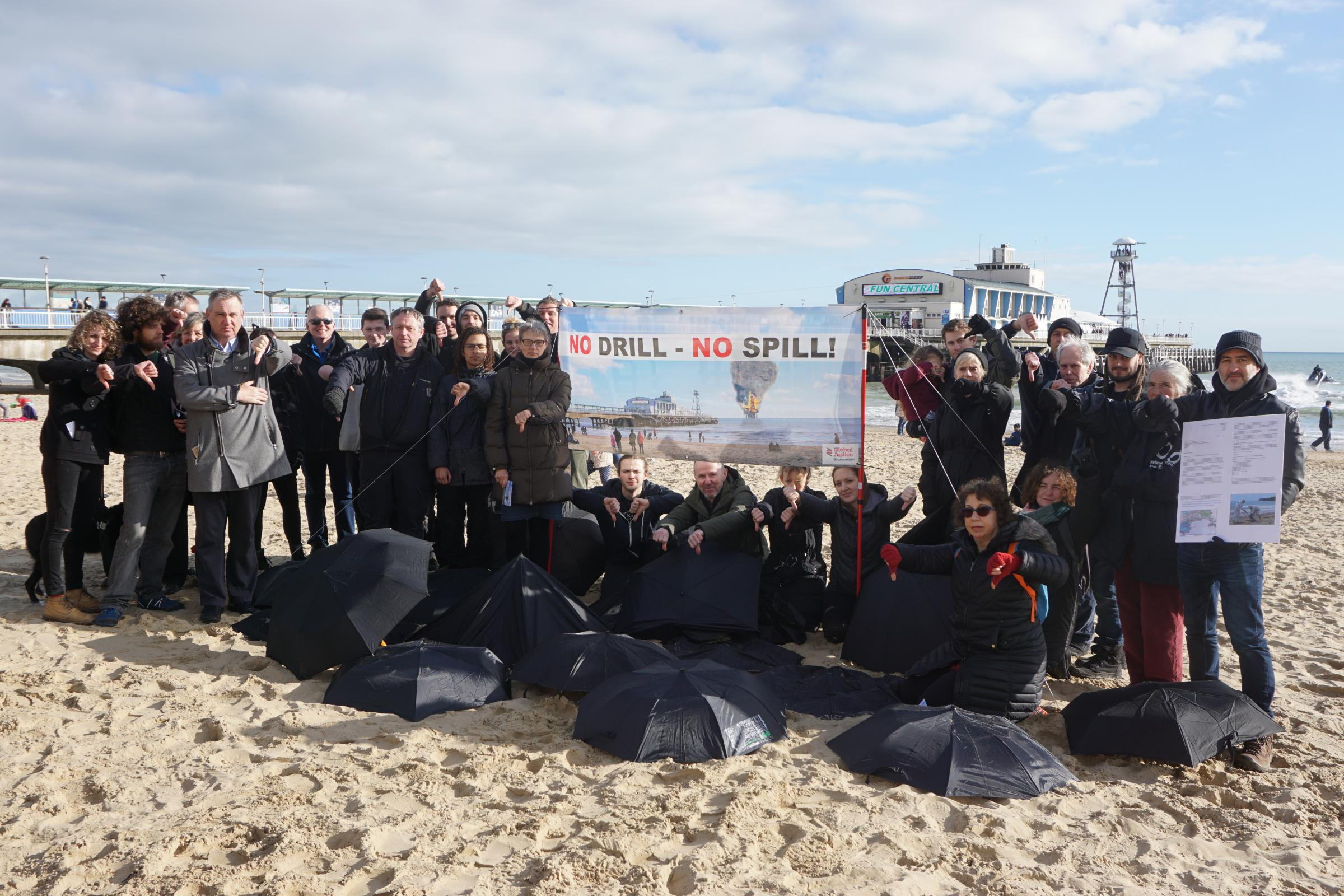 Protesters gather by Bournemouth Pier to raise awareness of plans to place an oil rig in Poole Bay