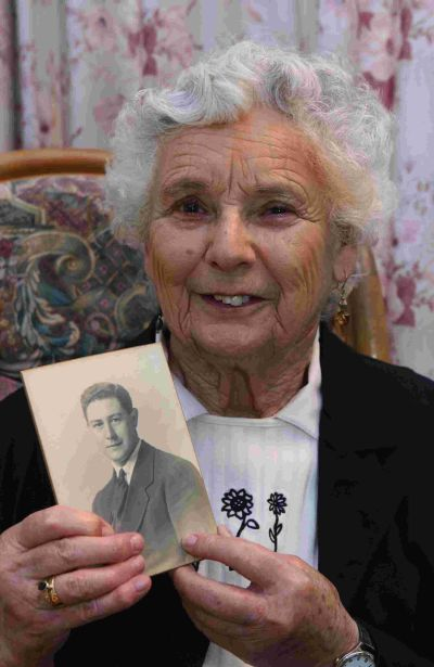 HOPE: Betty Webber, holding a picture of her uncle