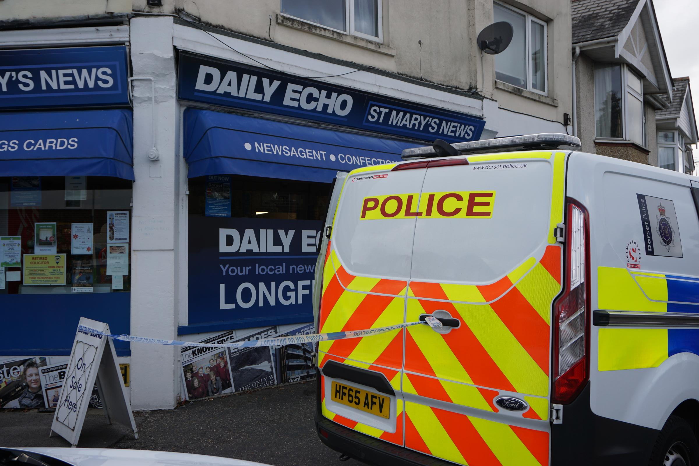 Police cordon off St Mary's News in Longfleet, Poole after an armed robbery on Tuesday morning