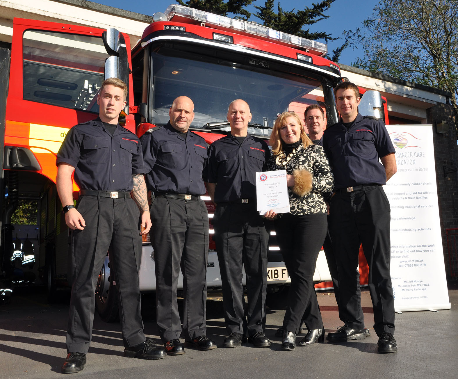 Officers of Christchurch Fire Station raised more than £1,200 for the Dorset Cancer Care Foundation with a giant tea party