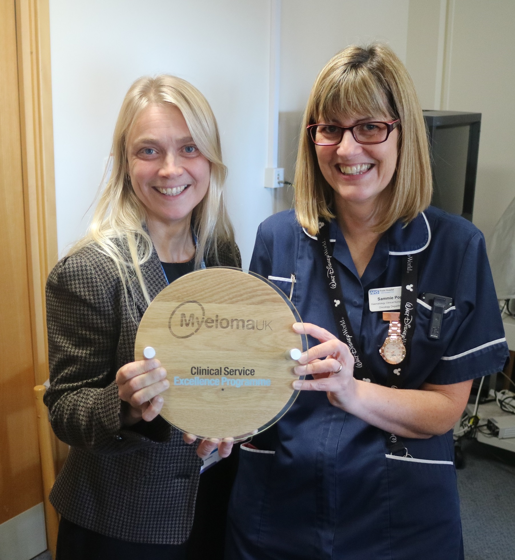 Dr Rebecca Maddams and Sammie Pope, haematology clinical nurse specialist, with the accreditation plaque