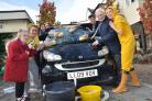 Carers, students and residents Mary Lamb and Jack Richardson took part in a charity, Children in Need car wash at Colten Care's The Aldbury in Poole