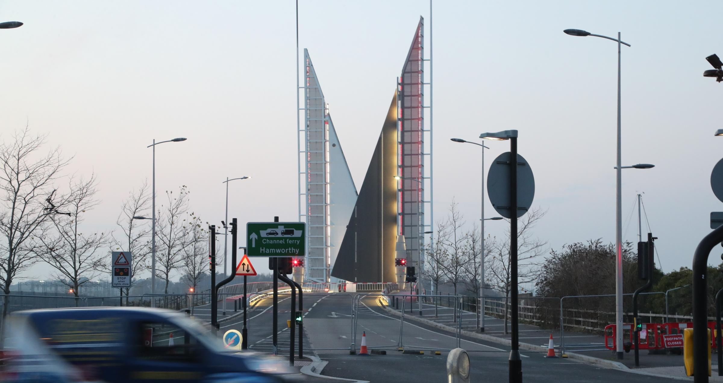 MYSTERY: The closed Twin Sails Bridge yesterday evening and, inset, Poole council's Julian McLaughlin
