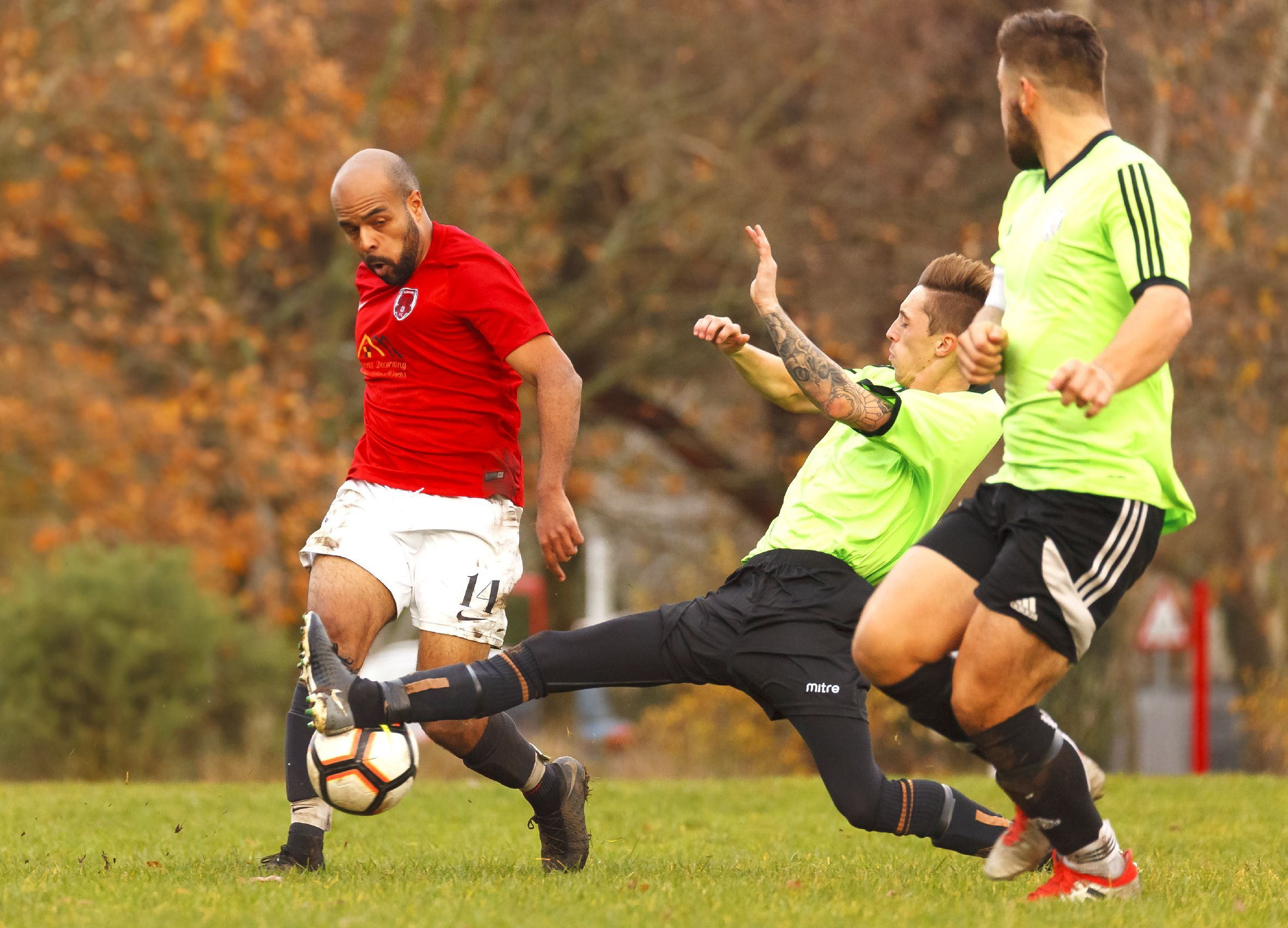 TOUGH BATTLE: Action from Rushmere's Hampshire Intermediate Cup defeat to Freehouse reserves (Picture: BHFL)