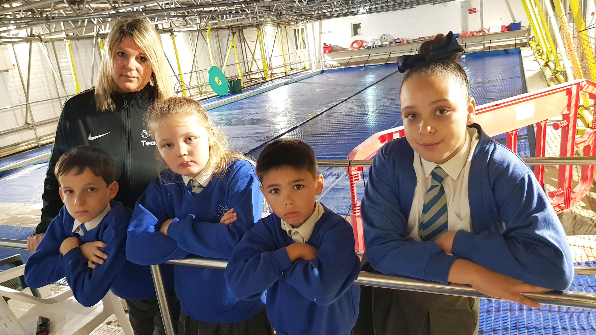 DEEP END: Swimming teacher Lisa Salamon with pupils at Talbot Primary School and their damaged swimming pool
