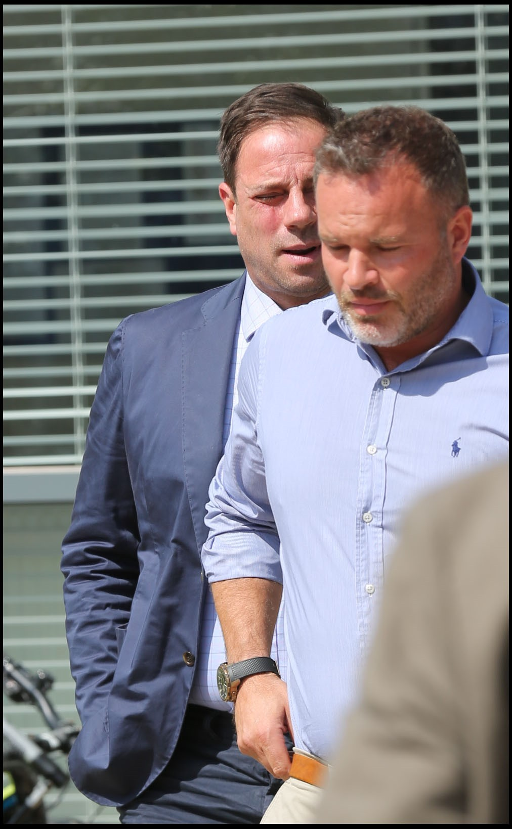 TRIAL DATE: Mark Redknapp, on left, arrives at court with a supporter