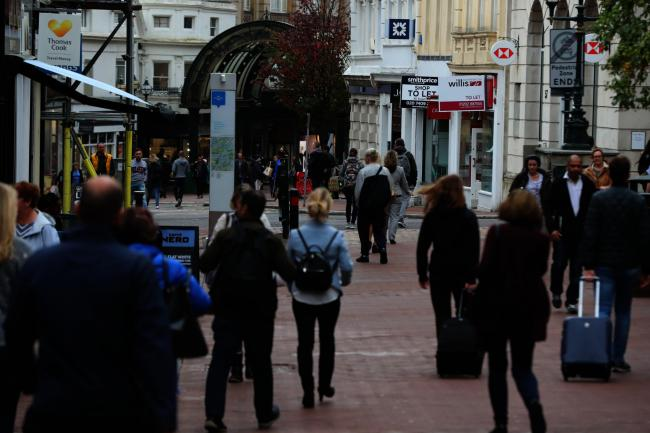 RUN DOWN? Shoppers pass the many to-let signs in Old Christchurch Road, Bournemouth