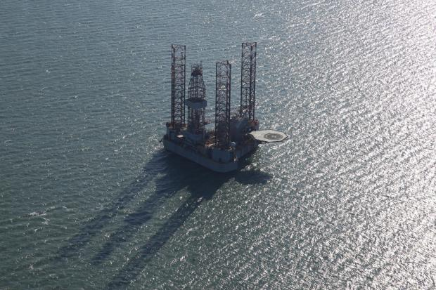 Bournemouth Echo: The oil rig, ENSCO 72, in Poole Bay. Picture: Bliss Aviation