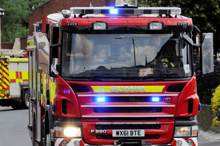 Crews alerted to engine fire in a vehicle in a workshop