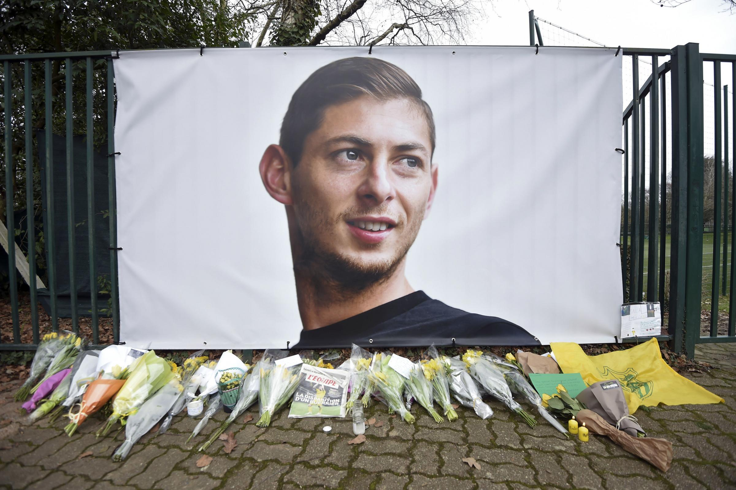 Flowers and tributes near a picture of Argentine soccer player Emiliano Sala
