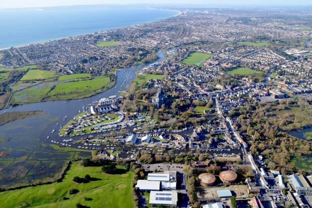 Must creidt Stephen Bath. Aerial view of Christchurch merging with Bournemouth, and Poole. November 2017