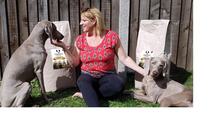Claire Addiscott, who founded the pet food brand Addiscotts, with her Weimaraners
