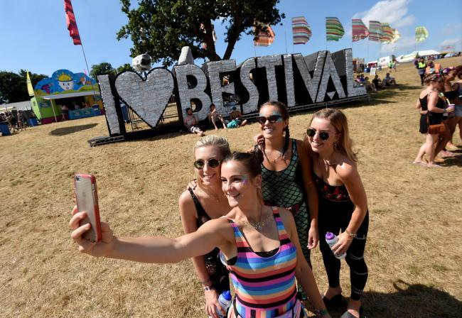 Festival goers take a selfie. Image by Finnbarr Webster Photography