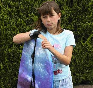 WAVE OF PROTEST: Scarlett Pledger, nine, from Parkstone, was knocked down by a speeding cyclist at Branksome Chine, but escaped serious injury thanks to her bodyboard