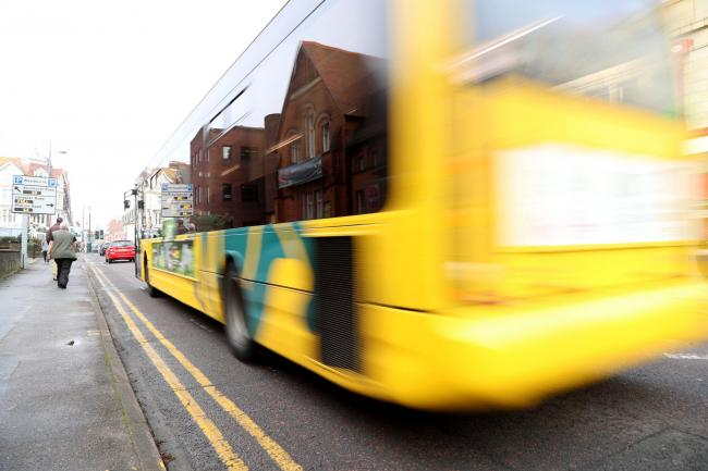 A Yellow Bus vehicle passing through Poole Road at Westbourne..