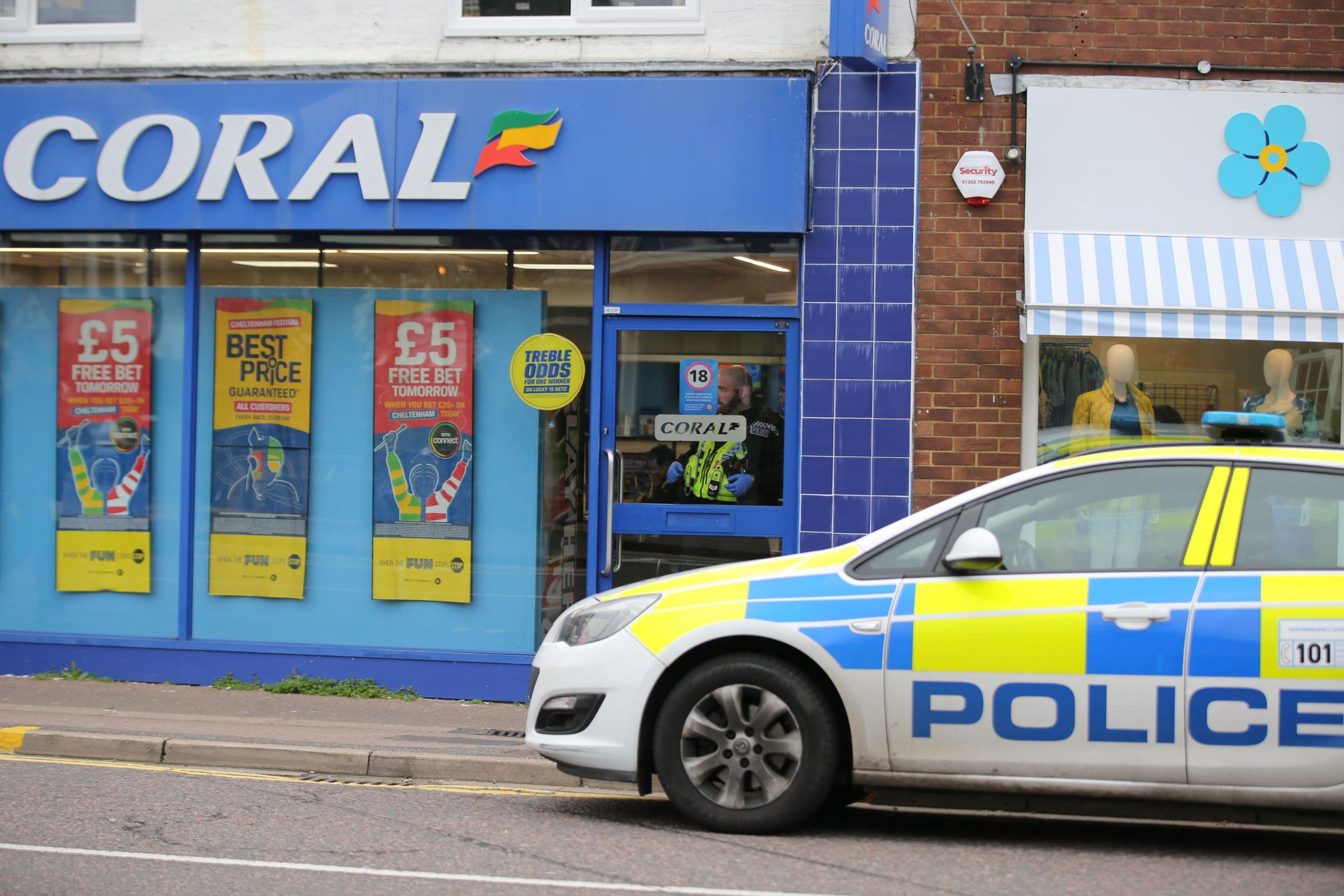 Police outside Coral in Westbourne after a robbery