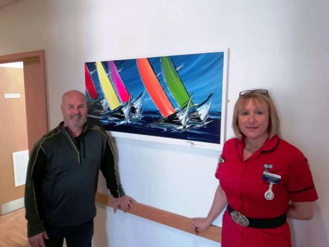 Stepehen and Benita with the new artwork