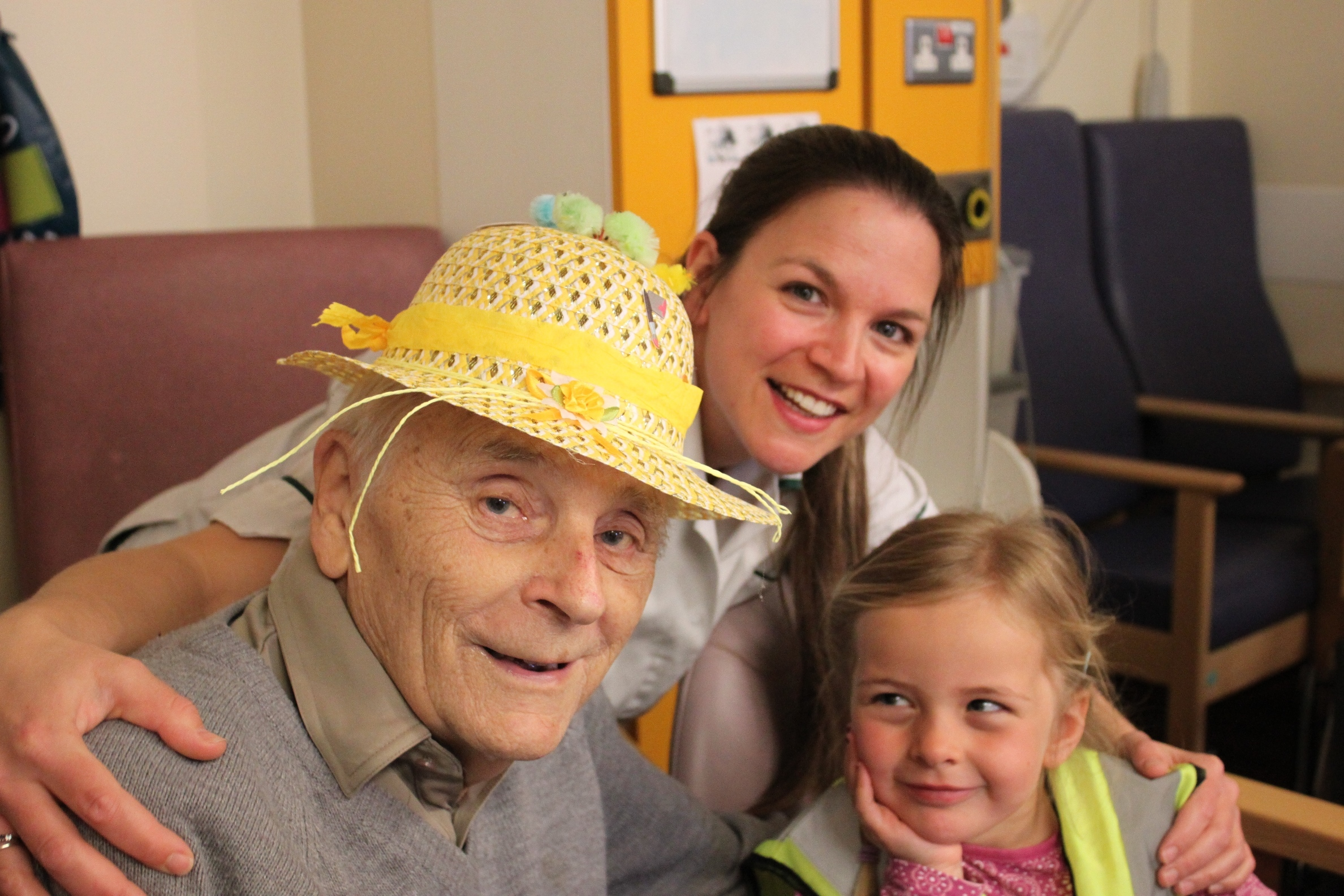 Patient Eric Mosley, RBH occupational therapist Heidi Hanslip and Harriet, who attends Tops Day Nursery