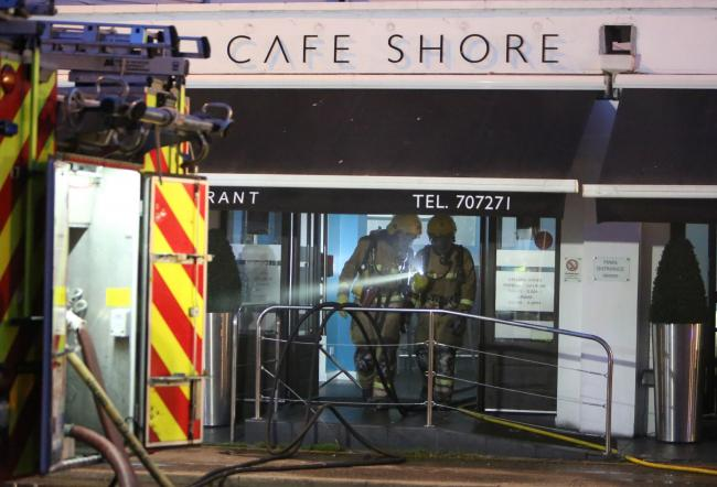 Firefighters at Cafe Shore in August 2014