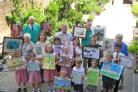 Winners in the Wimborne in Bloom art competition show off their pictures