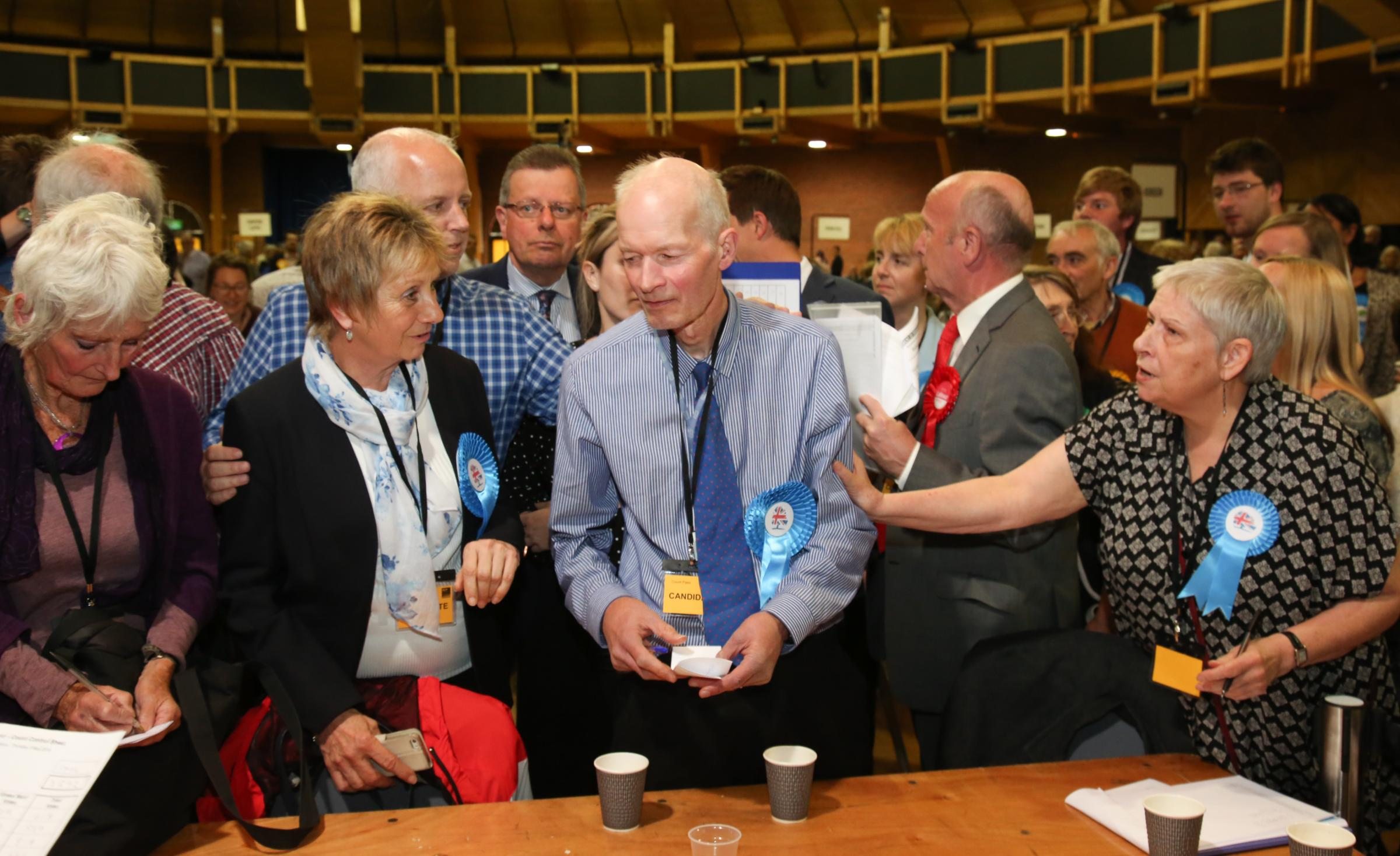 BCP Election count at The BIC , Bournemouth. Phil Stanley-Watts  is consoled after  not keeping his seat  in Boscombe West.