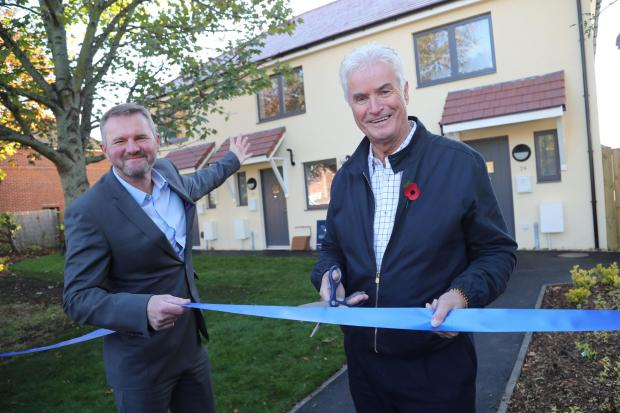 NEW LEADERSHIP: Cllr Lawton at the opening of three energy efficient homes with ex-housing director Gary Josey