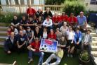 CHARITY INITIATIVE: Players and staff of AFC Bournemouth pictured with youngsters staying at YCT's Tracy Ann House