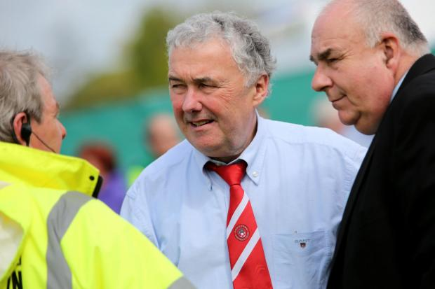 DEPARTURE: Chairman Chris Reeves, centre, praised the work of Dan Herrington after he left his role as reserve-team manager at Poole Town