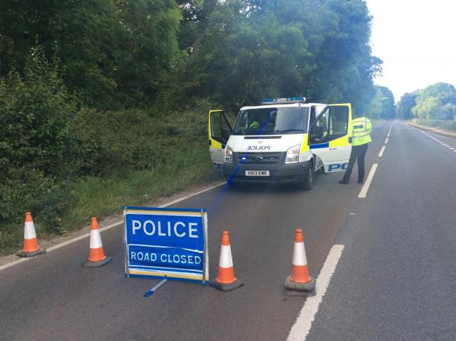 Police have closed the road following the accident