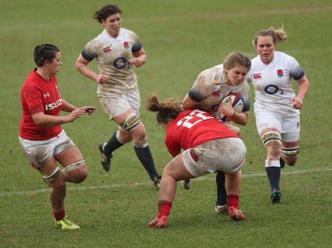 England's Poppy Cleall and Wales' Lleucu George during the NatWest Women's 6 Nations match at Twickenham Stoop, London. PRESS ASSOCIATION Photo. Picture date: Saturday February 10, 2018. See PA story RUGBYU England Women. Photo credit should r