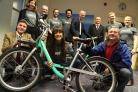Emily Brooke MBE CEO of Beryl Bikes, front centre, with one of the new cycles